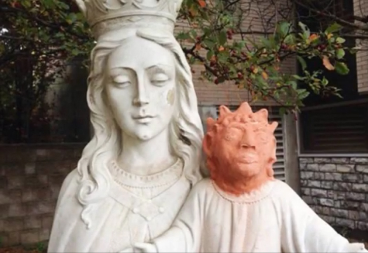 Heather Wise's attempted restoration of a statue of Jesus. Screen grab via YouTube courtesy of Coisas da Net.