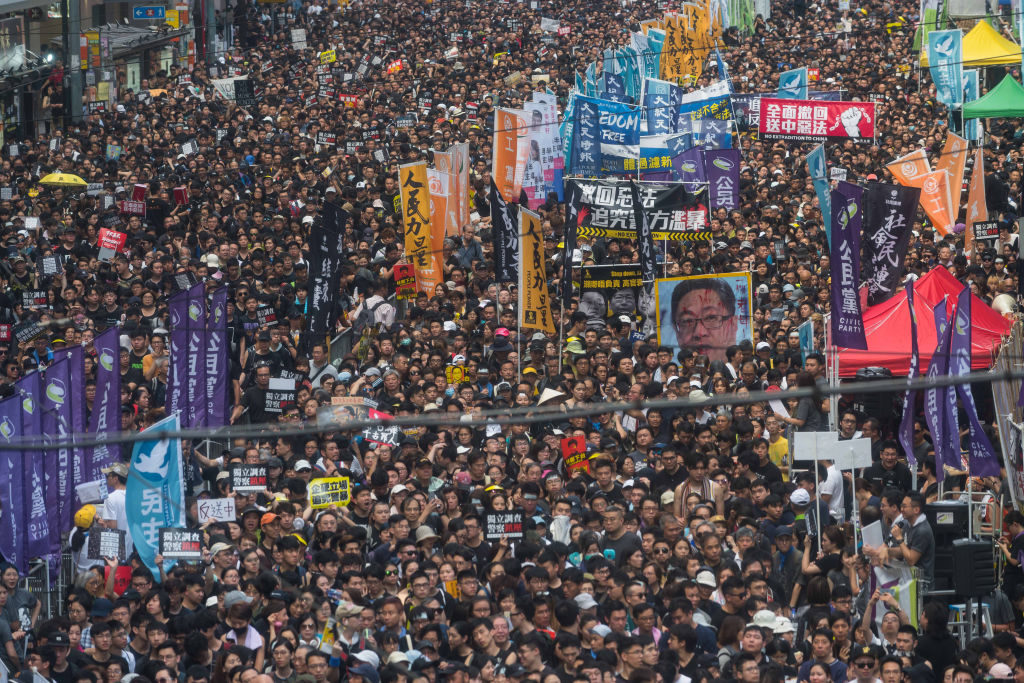 Protesters take part in a rally against extradition bill on July 1, 2019, in Hong Kong. Thousands of pro-democracy protesters faced off with riot police on Monday during the 22nd anniversary of Hong Kong's return to Chinese rule as riot police officers used batons and pepper spray to push back demonstrators. (Photo by Billy H.C. Kwok/Getty Images)