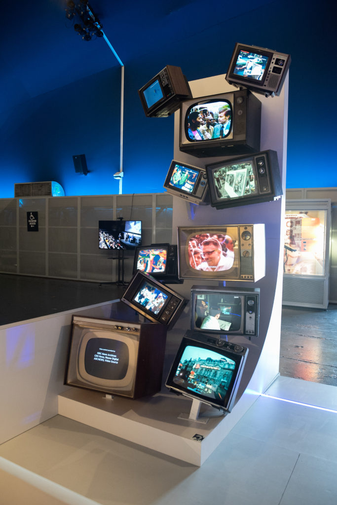 """Installation view of """"Media, the Moon and Beyond"""" at the Intrepid Museum. Courtesy of the Intrepid Museum."""
