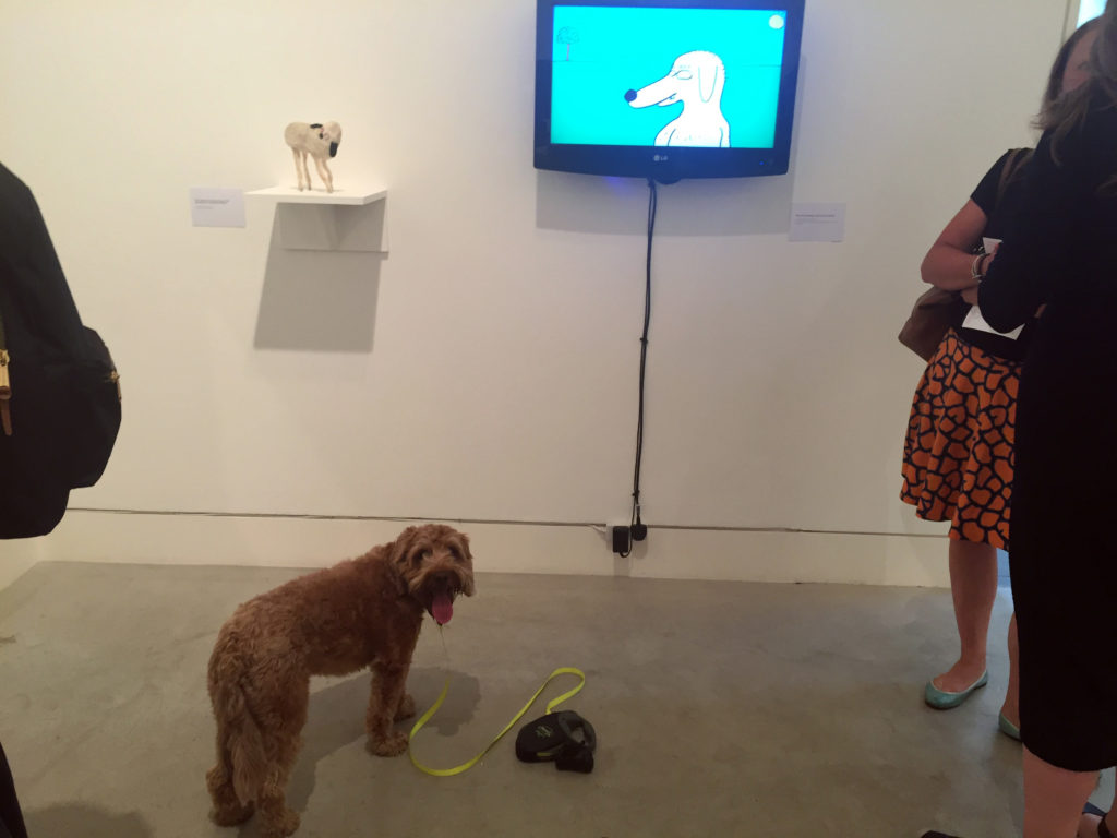 Pico poses in front of David Shrigley's Hello There (2012).