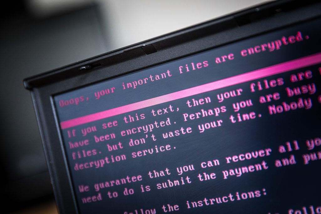 A laptop displays a message after being infected by a ransomware as part of a worldwide cyberattack that hit more than 200,000 victims in more than 150 countries in 2017. Photo AFP PHOTO/ANP/Rob Engelaar/Netherlands /Getty Images.