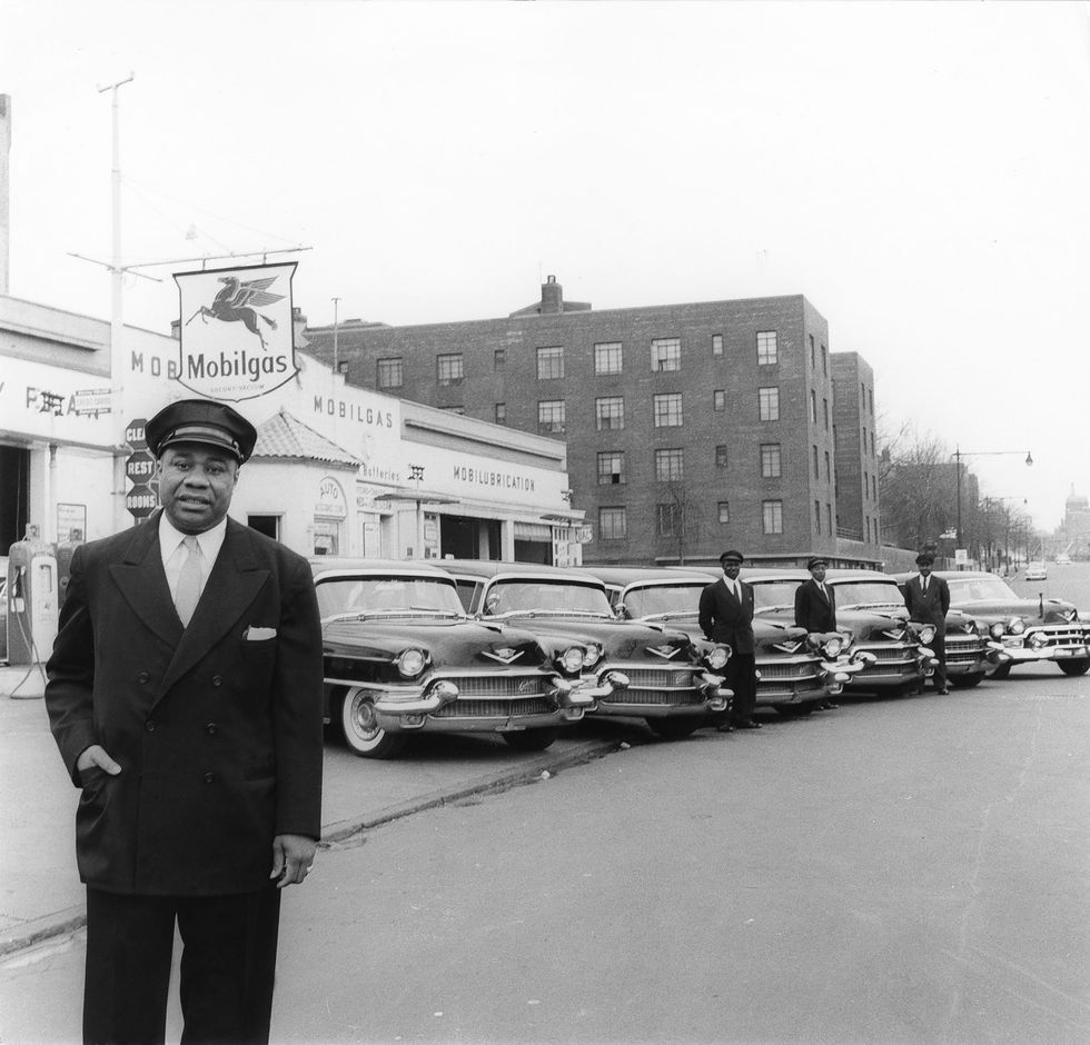Bertrand Miles, Roosevelt Zanders poses with the fleet of limousines he uses in his New York livery service, 1956. Photo courtesy of Johnson Publishing Company.