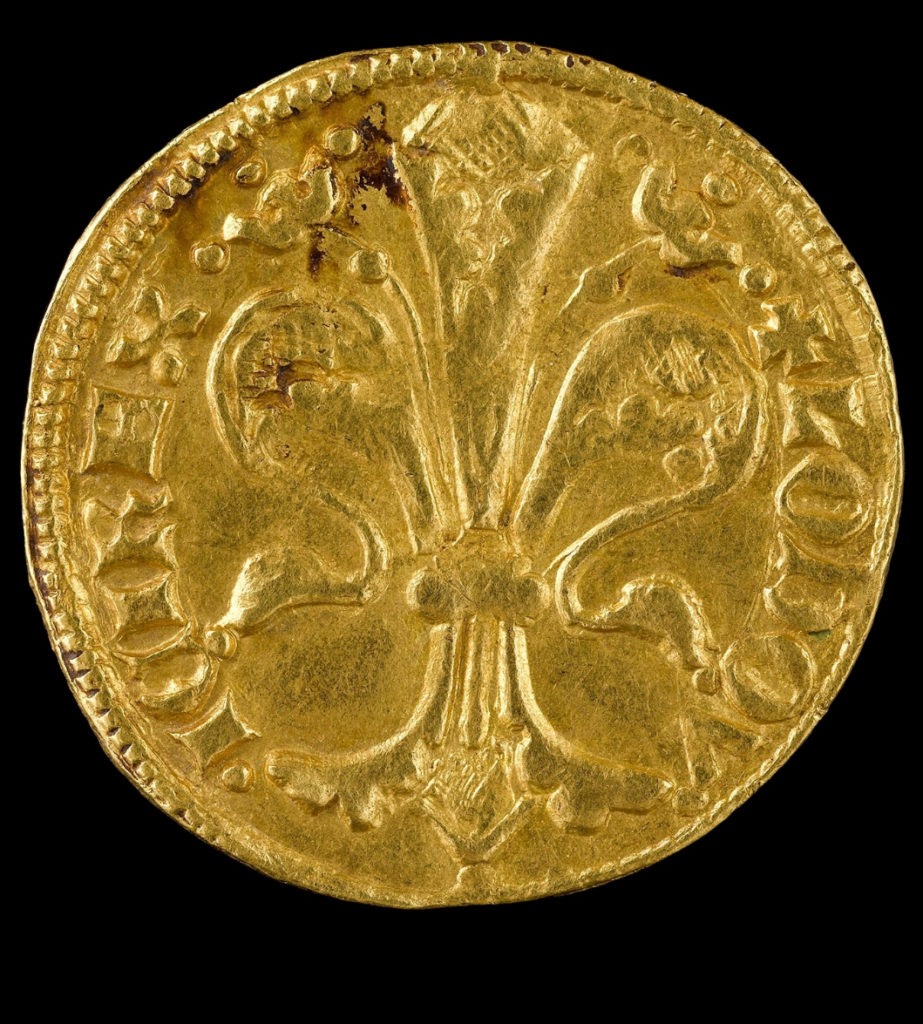 At left, a gold florin of Louis of Hungary from the Colmar Treasure (1342-53). Jewish families with more than 20 florins to their name had to pay a gold florin as an annual tax to the Holy Roman Empire. Photo courtesy of the Musée de Cluny – Musée national du Moyen Âge, RMN-Grand Palais/Art Resource, New York.