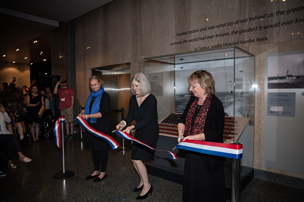 The ribbon cutting ceremony for donation of the D Day flag at the Smithsonian in Washington, D.C. <br>Image courtesy of the Smithsonian Institution.