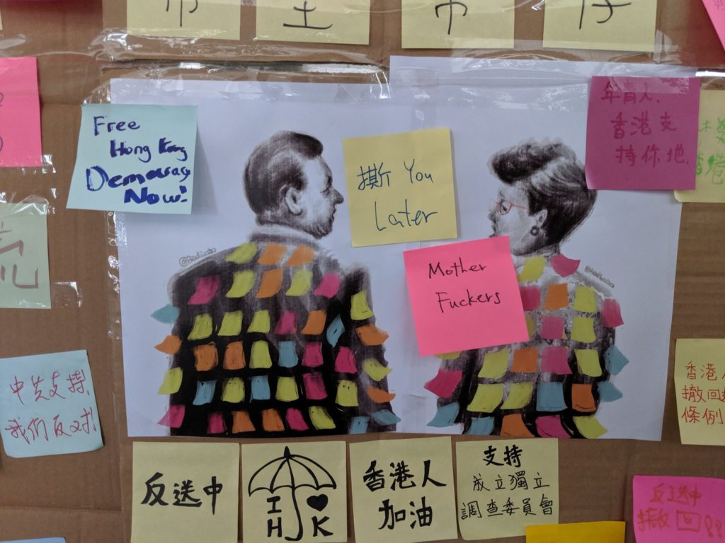 "An illustration of Chinese president Xi Jinping and Hong Kong chief executive Carrie Lam covered with Post-Its by Badiucao ends up on one of the ""Lennon walls"" in Hong Kong. Courtesy of Badiucao."