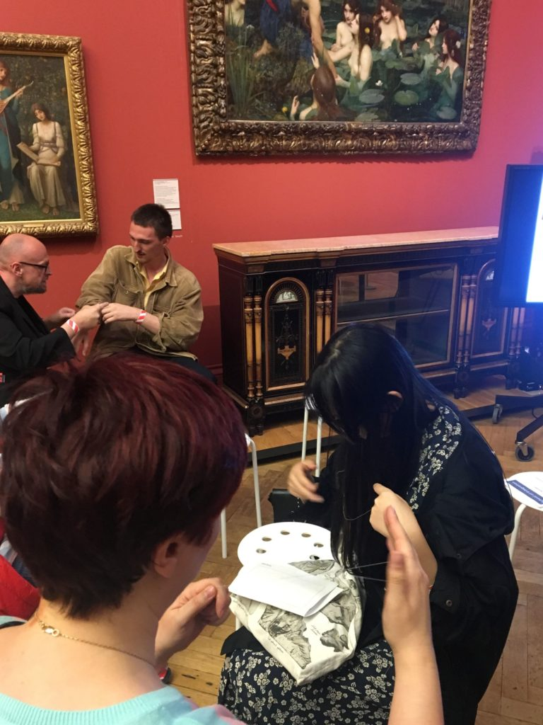 The School of Integration's Pakistan-style threading class in the Manchester Art Gallery. Photo by Javier Pes.
