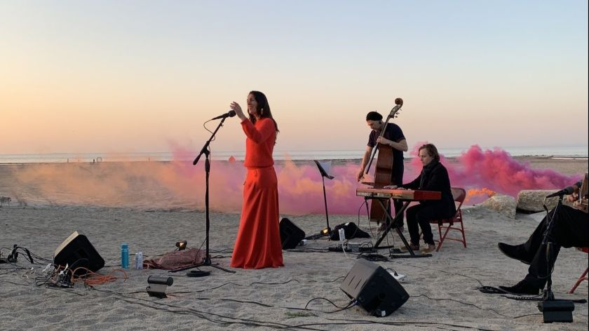 Ariana Vafadari performs an operatic piece, inspired by an ancient Iranian water deity, at the Bombay Beach Biennale. Photo by Gregg Pichler courtesy of the Bombay Beach Biennale.