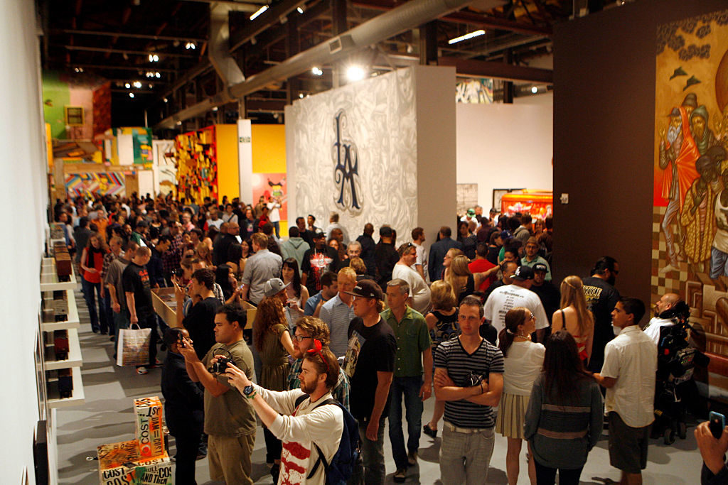 "People view art on display during the member's reception of ""Art in the Streets"" at the Geffen Contemporary at MOCA in Los Angeles, April 16, 2011. Photo by Ann Johansson/Corbis via Getty Images."