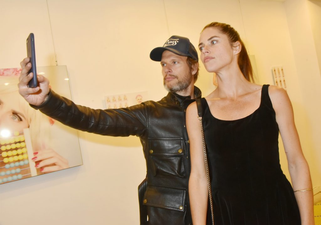 "Artist Zoe Duchesne and a guest pose for a selfie during the ""'Poupees' de Zoe Duchene"" preview at Galerie Marguerite Milin on September 13, 2018 in Paris, France. Photo by Foc Kan/WireImage."