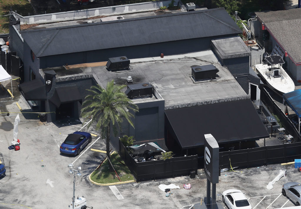 Law enforcement officials investigate at the Pulse gay nightclub where Omar Mateen allegedly killed at least 50 people on June 13, 2016 in Orlando, Florida. Photo: Joe Raedle/Getty Images.