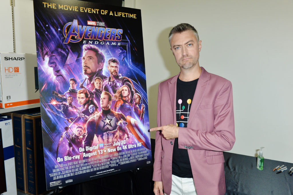 Actor Sean Gunn with a poster for Marvel's <i>Avengers: Endgame<i>. (Photo by Jerod Harris/Getty Images)