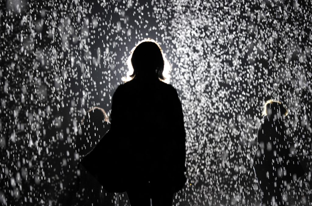 "MoMA PS1 presented Random International's <i>Rain Room</i> in 2013 as a major component of ""EXPO 1: New York,"" curated by Klaus Biesenbach. (TIMOTHY CLARY/AFP/Getty Images)"