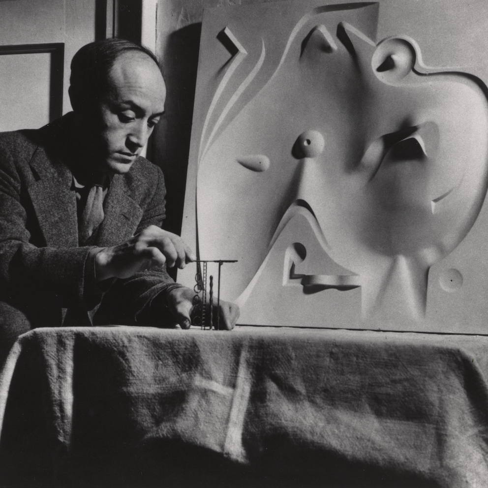 Isamu Noguchi with plaster model for <em>Contoured Playground</em> (1941) and model for a jungle gym element for Ala Moana Park (circa 1940). Photo courtesy of the Noguchi Museum Archive, ©INFGM/ARS.