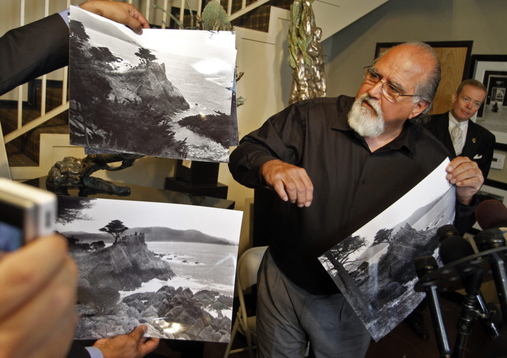 Rick Norsigian showing prints from found negatives by Ansel Adams. (Photo by Lawrence K. Ho/Los Angeles Times via Getty Images)