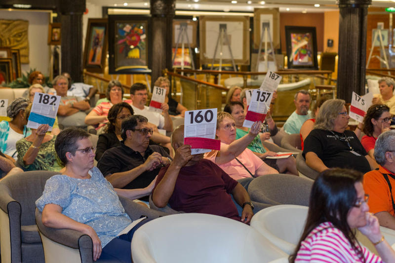 A Park West art auction in the Star Lounge on Royal Carribbean's Navigator of the Seas. Courtesy Cruise Critic.
