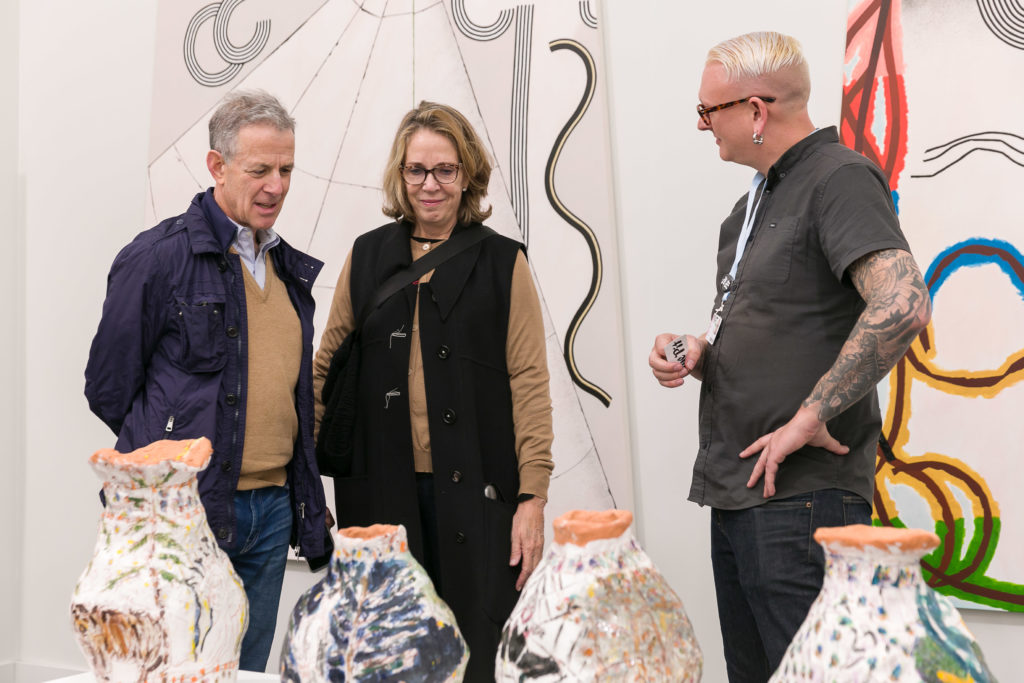 Visitors engaging with gallerists at Frieze Los Angeles. Photo: Mark Blower, courtesy of Frieze.
