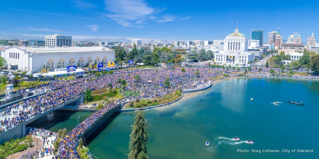Warriors fans take to the streets of Oakland. The Oakland Museum of California is behind the trees in the center of the photograph, next to the large white building on the left, but is almost impossible to make out Photo by Greg Linhares, courtesy of the city of Oakland.