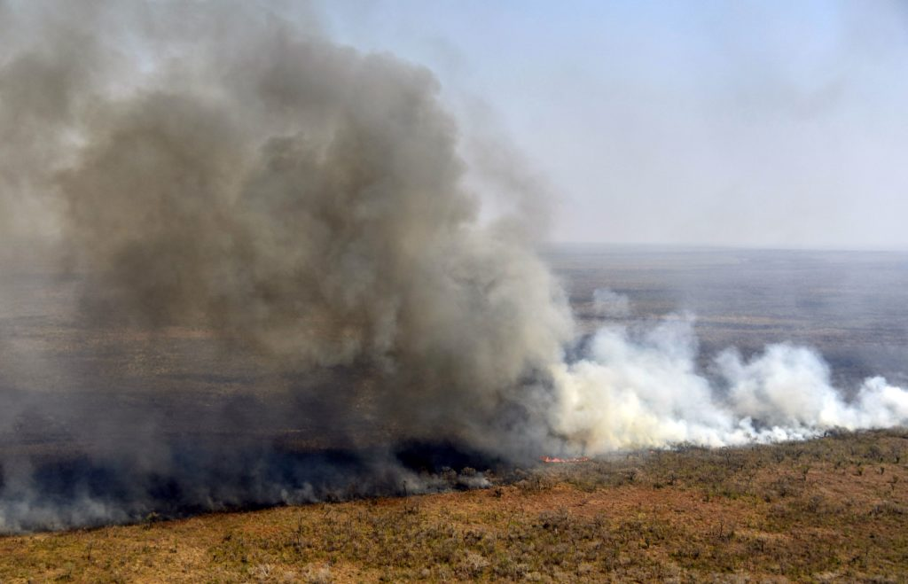 Aerial view of smoke billowing from a fire near Charagua in Bolivia, on the border with Paraguay, south of the Amazon basin, on August 29, 2019. Fires have destroyed 1.2 million hectares of forest and grasslands in Bolivia this year, the government said on Wednesday, although environmentalists claim the true figure is much greater. (Photo by Aizar Raldes/AFP/Getty Images.